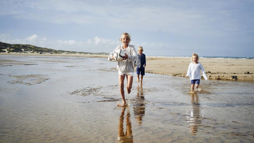 Kids running on Saltum Beach in North Jutland