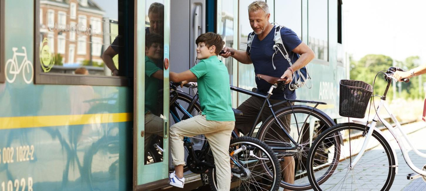 Family with bike in the train, Thisted