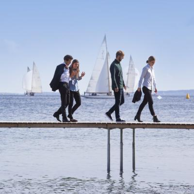 Business people walking on Aarhus infinity bridge