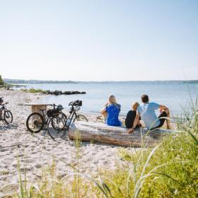 Family at a beach with their bikes in Southjutland
